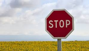 setting limits - stop sign in a country scene